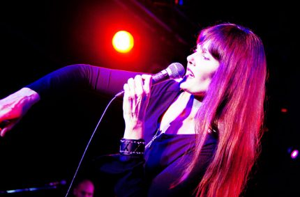 Pamela Falcon performing at a New York Nights show